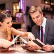Elegant couple in restaurant — Stock Photo
