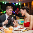 Couple in restaurant toasting — Stock Photo