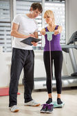 Personal instructor checking results — Stock Photo