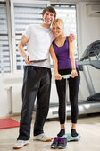 Personal trainer with client — Stock Photo