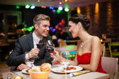 Couple in restaurant toasting — Stock Photo