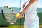 Racket and tennis ball — Stock Photo