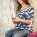 Teenager girl using her smart phone — Stock Photo #42791487