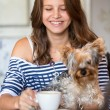 Happy smiling teen girl holding little dog — Stock Photo