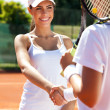 Handshaking at the tennis court after a match — Stock Photo