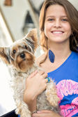 Smiling girl with her dog — Foto Stock