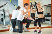 Workout with fitness straps — Stock Photo