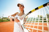 Tennis player with racquet expecting a ball — Stock Photo