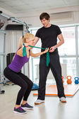 Woman exercising  with rubber bands — Photo