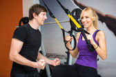 Sportswoman exercising with a resistance band — Stock Photo