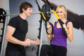 Personal trainer assist woman — Stock Photo