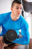 Sportman doing weights lifting — Stock Photo