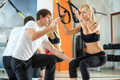 Suspension training with fitness straps — Stock Photo