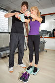 Fitness instructor  with female client — Stock Photo