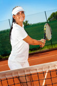 Girl practicing tennis — 图库照片