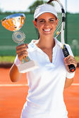 Tennis player showing golden goblet  — Stock Photo