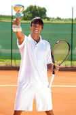 Successes tennis player — Stock Photo