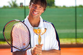 Smiling tennis winner — Stock Photo