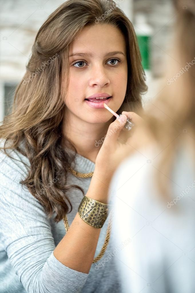 Beautiful teen girl with lip gloss stock photo for Beautiful small teen