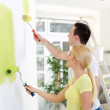 Couple painting wall at home — Stock Photo #44164571