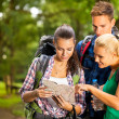 Three hikers watching the map — Stock Photo #44167291