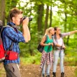 Photographer taking photo during hike — Stock Photo