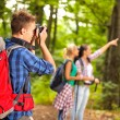 Man in forest with camera — Stock Photo