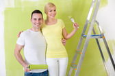 Love couple painting home — Stock Photo