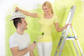 Funny couple painting — Stock Photo