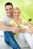 Couple relaxing after painting — Stock Photo