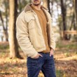 Young man wearing autumn fashionable clothing — Stock Photo #46651279