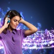 Young woman with headphones listening to music — Stock Photo #47493857