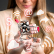 Shopping chart in hands surrounds shopping icons — Stock Photo