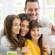 Family with little girls making self portrait — Stock Photo