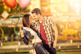 Affectionate couple having fun in amusement park — Stock Photo