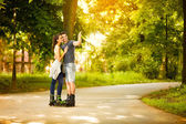 Love young couple on rollerblades  — Stock Photo