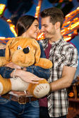 Romantic couple at amusement park — Stock Photo