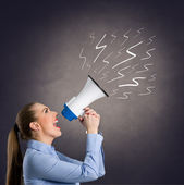 Leader woman  shouting into megaphone — Stock Photo