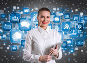 Smiling businesswoman over technology background  — Stockfoto