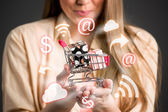 Shopping chart in hands surrounds shopping icons — ストック写真