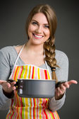 Portrait of cheerful housewife — Stockfoto