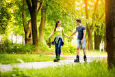 Young sporty couple ride rollerblades — Stock Photo