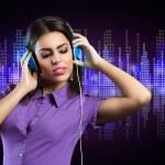 Young woman enjoying in music — Stock Photo #48049437