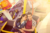 Young couple having a ride on a ferris wheel — Stock Photo