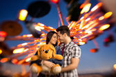 Affectionate couple visiting an attractions park  - shoot with l — Stock Photo