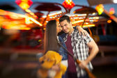 Romantic scene in amusement park  - shoot with lensbaby — Stock Photo