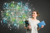 Young female student with clouds of bright formulas, numbers, le — Stock Photo