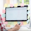 Man sitting front monitor with notes on it — Stock Photo #48051105
