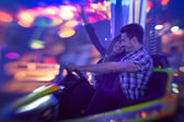 Couple having fun in bumper car — Stock Photo