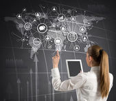 Woman holding tablet and media icons — Stock Photo